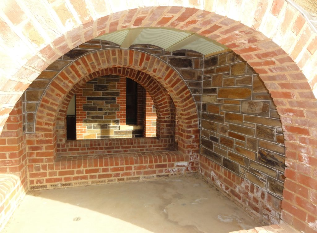 Chimneys fireplaces arches ace brick and stonework - Covering brick fireplace with tile ...